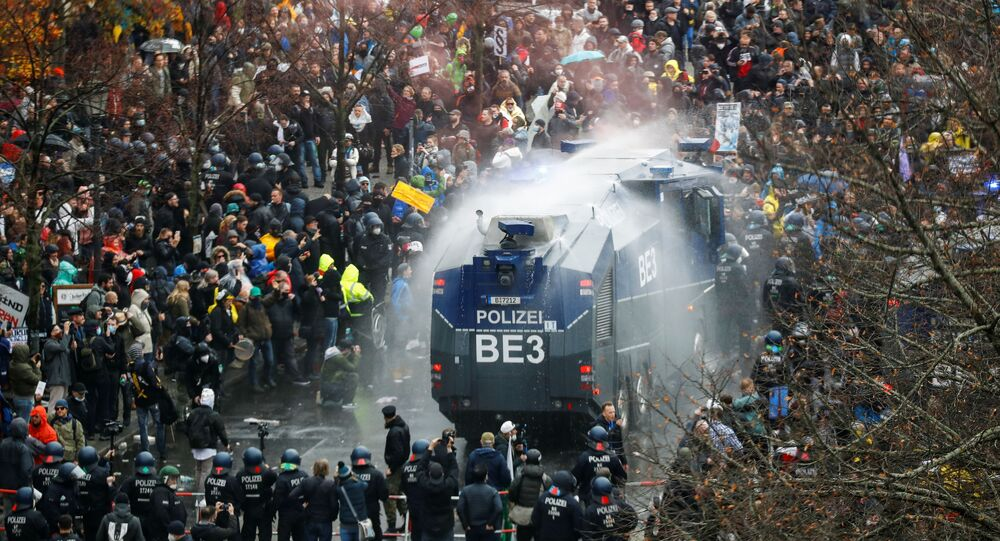 German police fire water cannon at anti-COVID restriction protesters