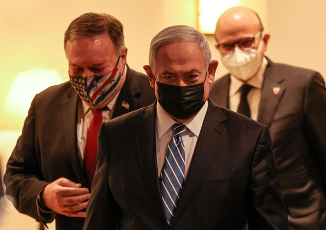 US Secretary of State Mike Pompeo, Israeli Prime Minister Benjamin Netanyahu, and Bahrain's Foreign Minister Abdullatif bin Rashid Al Zayani, all mask-clad due to the COVID-19 coronavirus pandemic, arrive for a press conference after their trilateral meeting in Jerusalem on November 18, 2020.