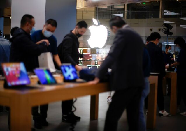 People look at Apple products at an Apple Store, as the coronavirus disease (COVID-19) outbreak continues in Shanghai China October 23, 2020.