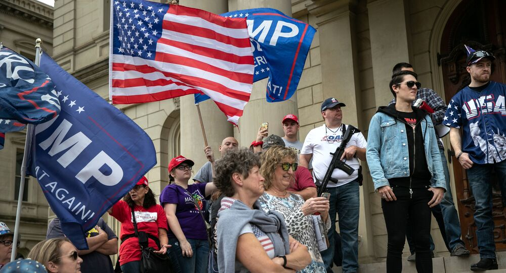 Trump supporters demonstrate at the Michigan state capitol on November 08, 2020 in Lansing, Michigan. Militia members had pledged to attend the Stop the Steal demonstration, claiming the presidential election had been stolen.