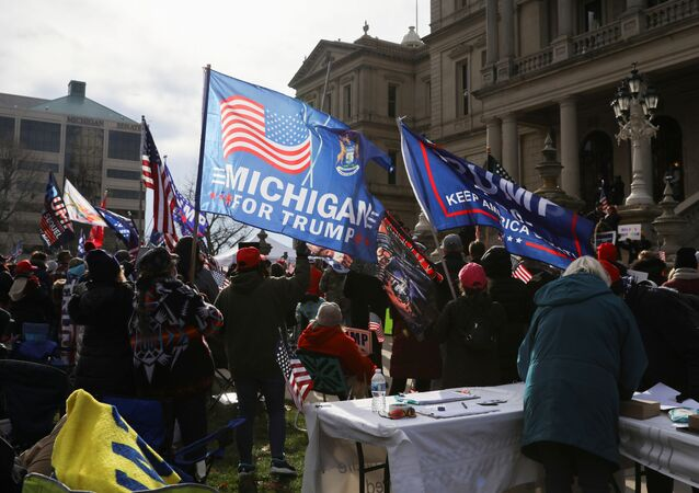 Supporters of U.S. President Donald Trump participate in a Stop the Steal protest after the 2020 U.S. presidential election was called for Democratic candidate Joe Biden, in Lansing, Michigan, U.S. 14 November 2020.
