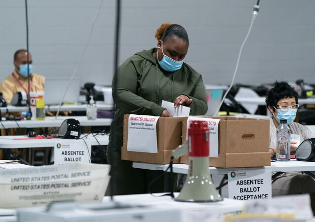 Election personnel sort ballots in preparation for an audit at the Gwinnett County Board of Voter Registrations and Elections offices on 7 November 2020 in Lawrenceville, Georgia. Several counties in Georgia continued to count ballots even as news outlets have declared Joe Biden the winner of the race for President.