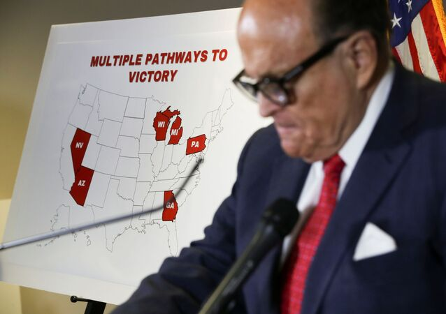 Former New York City Mayor Rudy Giuliani, personal attorney to U.S. President Donald Trump, stands in front of a map of election swing states marked as Trump Pathways to Victory during a news conference about the 2020 U.S. presidential election results held at Republican National Committee headquarters in Washington, U.S., November 19, 2020