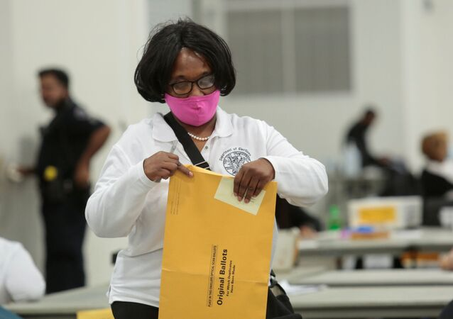 A poll worker supervisor handles an envelope of original ballots at the TCF center after Election Day in Detroit, Michigan, U.S., November 4, 2020
