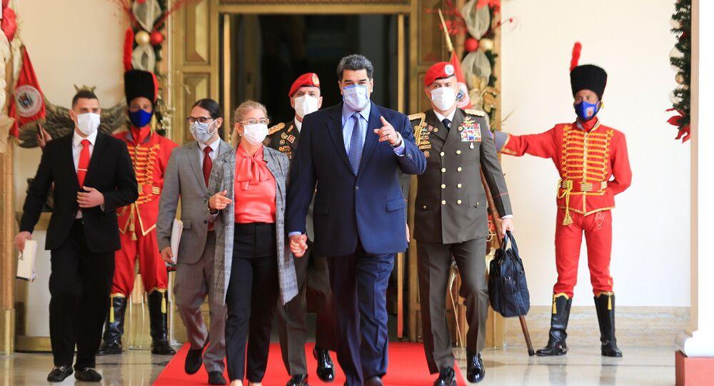 Venezuela's President Nicolas Maduro walks before holding a virtual news conference in Caracas, Venezuela October 28, 2020.