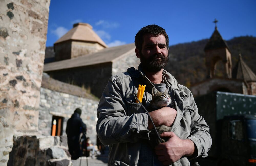 A man holds a cat near the temple in the Dadivank monastery in Nagorno-Karabakh. The monastery is located in the Kelbajar region, which, in accordance with the tripartite agreement between the leaders of Russia, Armenia and Azerbaijan must be returned to Azerbaijan by 15 November.