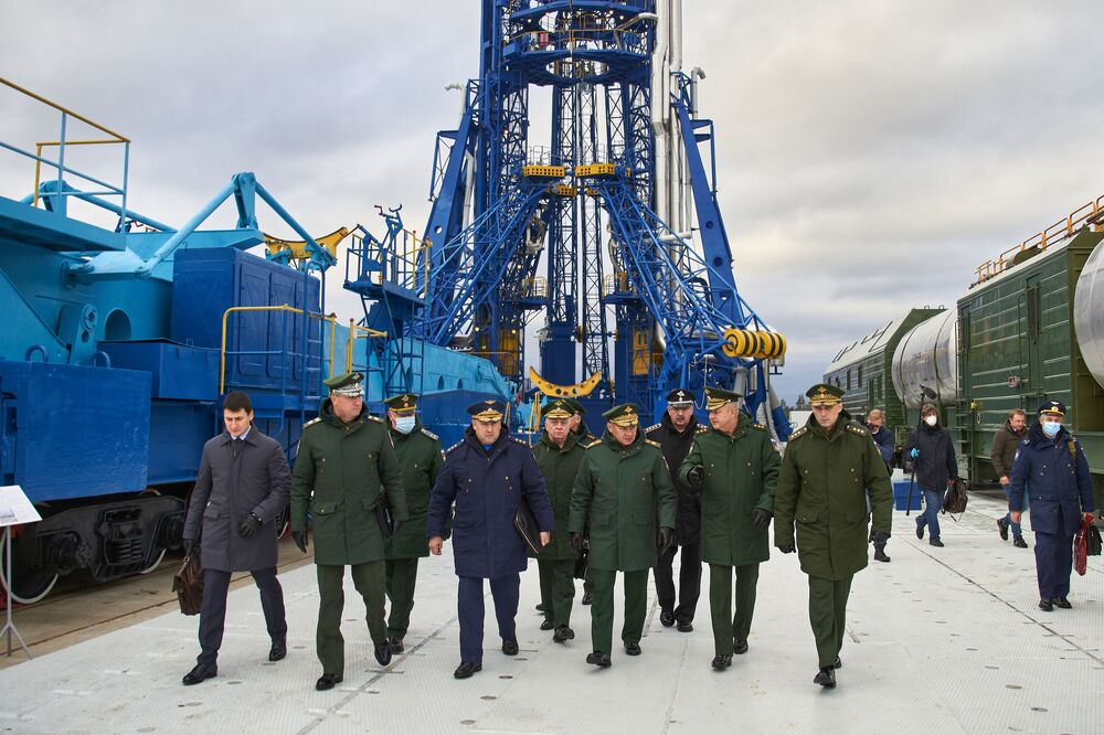Russian Defence Minister Sergei Shoigu (centre) checks the preparation for the launch of the Angara-A5 heavy-class rocket during a working trip to the Plesetsk cosmodrome.