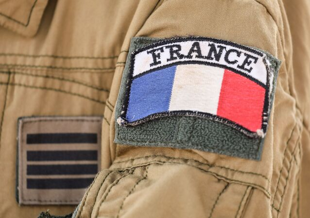 The badge of France's Barkhane mission in Africa's Sahel region, is seen on a soldier's uniform, on the French Air Force base in Niamey on December 22, 2017.