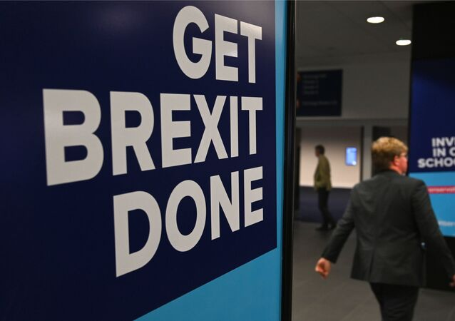 Conservative Party branding encouraging them to Get Brexit Done and Invest in our Schools is seen at the Manchester Central convention complex in Manchester, north-west England on September 29, 2019, on the first day of the annual Conservative Party conference. - Embattled British Prime Minister Boris Johnson gathered his Conservative party Sunday for what could be its final conference before an election, promising to get Brexit done.