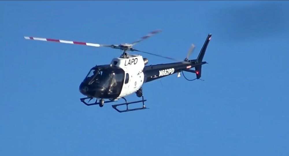 Screenshot image captures helicopter operated by California's Los Angeles Police Department as it makes several passes near Venice Beach in March 2019.