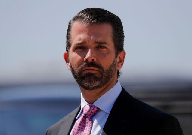 Donald Trump Jr. arrives with his father U.S. President Donald Trump after landing aboard Air Force One at General Mitchell International Airport in Milwaukee, Wisconsin, U.S., July 12, 2019