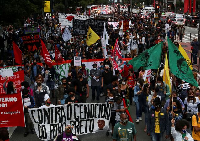 Demonstrators march in Sao Paulo during the National Black Consciousness Day and in protest against the death of Joao Alberto Silveira Freitas, a Black man beaten to death at a market in Porto Alegre, Brazil November 20, 2020