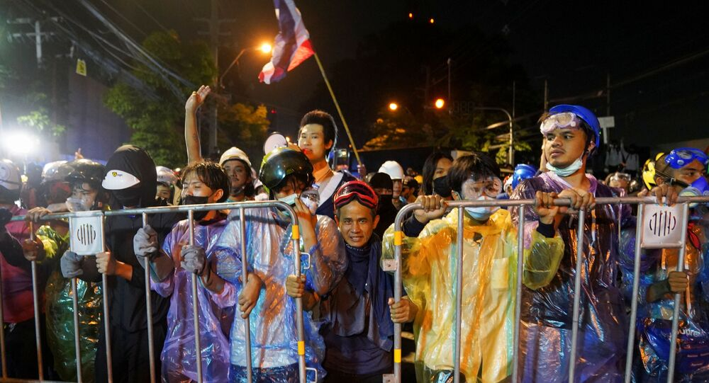 Demonstrators move barriers during an anti-government protest as lawmakers debate on constitution change, outside the parliament in Bangkok, Thailand, November 17, 2020.