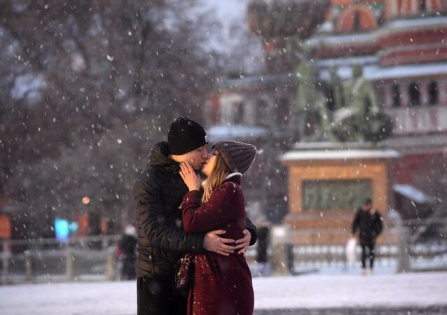 A pair is kissing in Red Square in Moscow