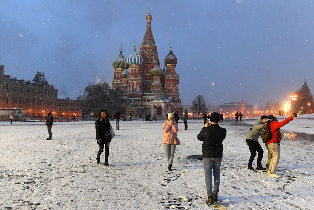 People take selfies in snowy Red Square in Moscow