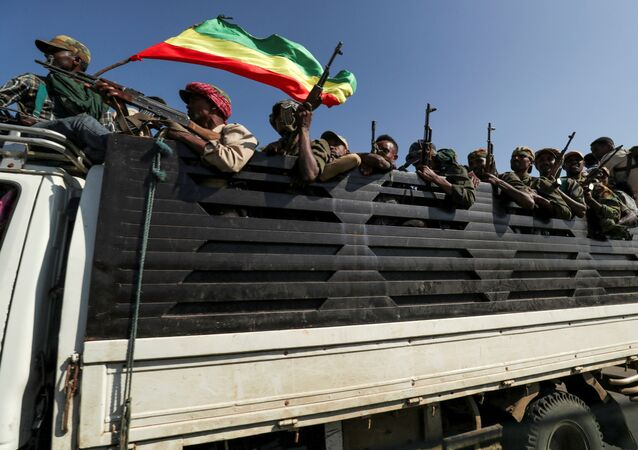 Members of Amhara region militias ride on their truck as they head to face the Tigray People's Liberation Front (TPLF), in Sanja, Amhara region near the border with Tigray, Ethiopia, 9 November 2020