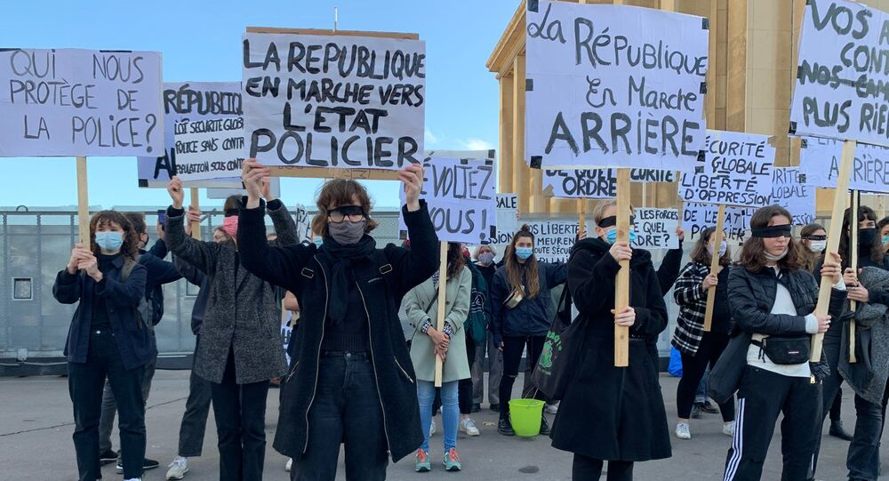 Protests in Paris against 'global security' bill approved by French National Assembly