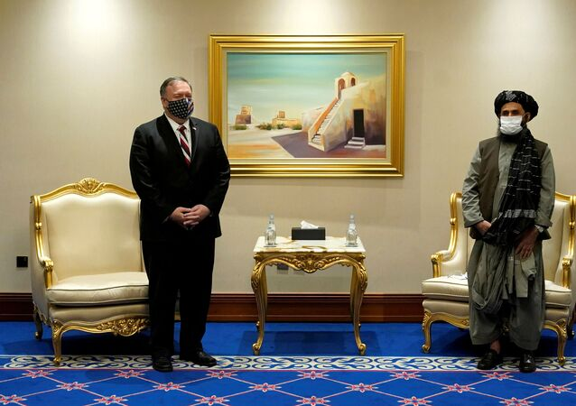 U.S. Secretary of State, Mike Pompeo, meets with Taliban chief negotiator, Mullah Abdul Ghani Baradar, amid talks between the Taliban and the Afghan government, in Doha, Qatar November 21, 2020.