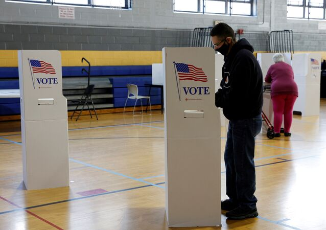 Voters fill out their ballots on Election Day in Conshohocken, Pennsylvania, U.S., November 3, 2020.
