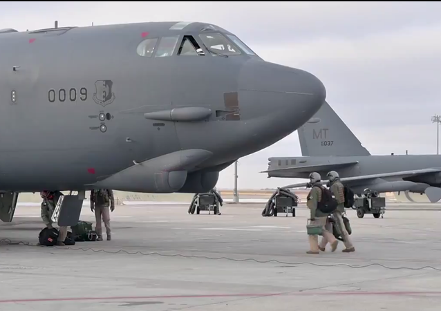 A screenshot of a video showing B-52 bomber being prepared for the flight at the military base in North Dakota, US