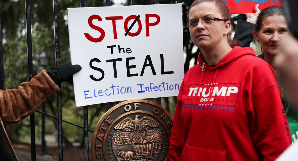 Supporters of U.S. President Donald Trump protest against restrictions put in place to limit the spread of coronavirus disease (COVID-19) and election results outside the governor's mansion, Mahonia Hall, in Salem, Oregon, U.S., November 21, 2020