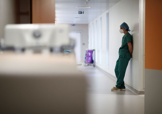 A medical staff member works in the Intensive Care Unit (ICU) where patients suffering from the coronavirus disease (COVID-19) are treated at the Melun-Senart hospital, near Paris, France, November 20, 2020