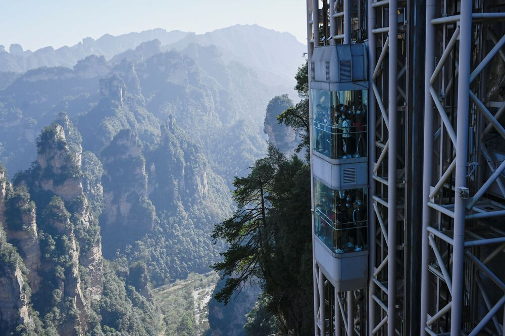 Tourists take the Bailong Elevator in Zhangjiajie National Forest Park, China's Hunan province.