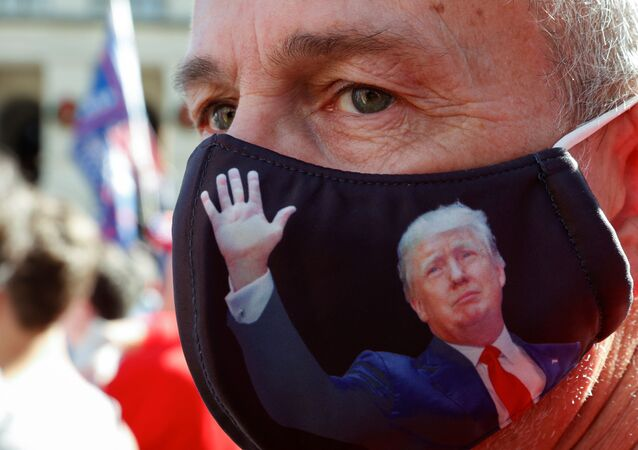 Doug Roman wearing a US President Donald Trump protective mask takes part in a protest against the results of the 2020 presidential election in Atlanta, Georgia, US, 21 November 2020.