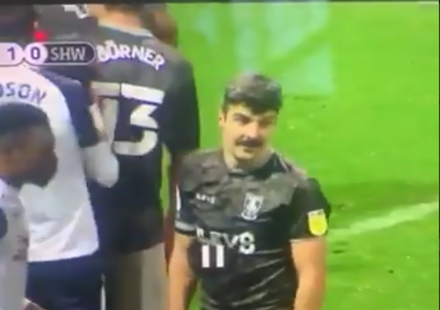 A screenshot of Fisher and Paterson taken from a video of a football match between Preston North End FC and Sheffield on Wednesday, 21 November, 2020.