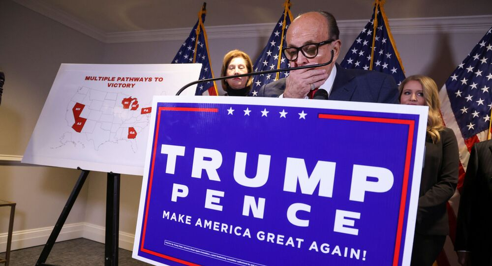 Former New York City Mayor Rudy Giuliani, personal attorney to U.S. President Donald Trump, speaks as he holds a news conference about the 2020 U.S. presidential election results with fellow Trump attorneys Sidney Powell and Jenna Ellis at Republican National Committee headquarters in Washington, U.S., November 19, 2020