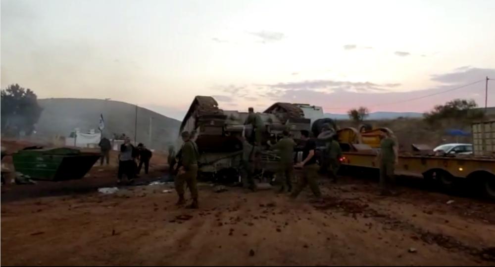 A screenshot from the social media video showing the Israeli Merkava tank flipped over the carrier, 22 November 2020