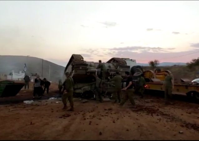 A screenshot from the social media video showing the Israeli Merkava tank flipped over the carrier, 22 November 2020