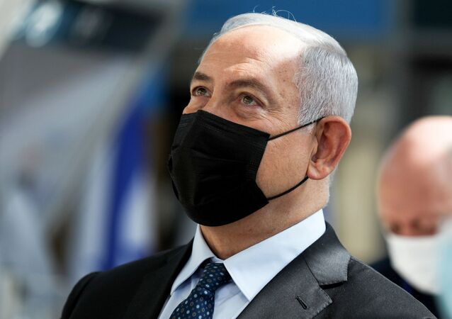 FILE PHOTO: Israeli Prime Minister Benjamin Netanyahu visits the new COVID-19 checking system at Ben-Gurion International Airport, near Tel Aviv, Israel  November 9, 2020