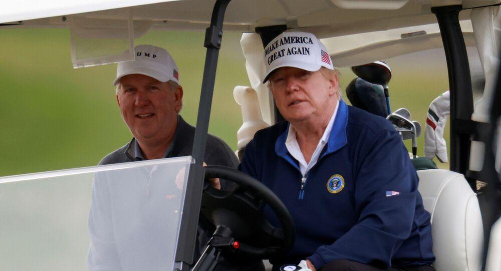 U.S. President Donald Trump drives a golf cart at the Trump National Golf Club in Sterling, Virginia, U.S., November 22, 2020