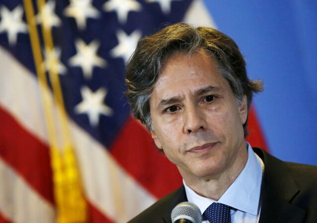 U.S. Deputy Secretary of State Antony Blinken listens to journalists' questions during a news conference, at a hotel in Mexico City April 30, 2015