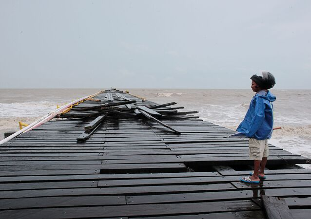 A man observes a dock damaged by the passing of Hurricane Iota, in Puerto Cabezas, Nicaragua November 17, 2020. Picture taken November 17, 2020.