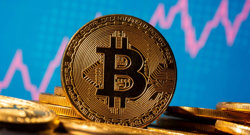 A representation of virtual currency Bitcoin is seen in front of a stock graph in this illustration taken November 19, 2020.
