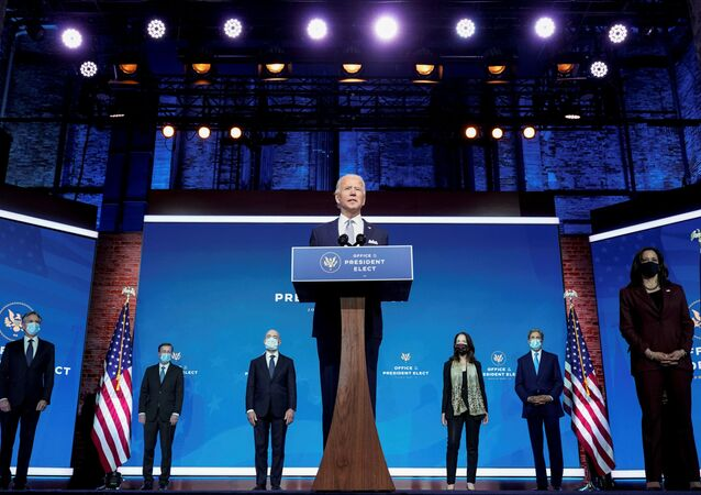 President-elect Joe Biden stands with his nominees for his national security team at his transition headquarters in the Queen Theater in Wilmington, Delaware, U.S., November 24, 2020