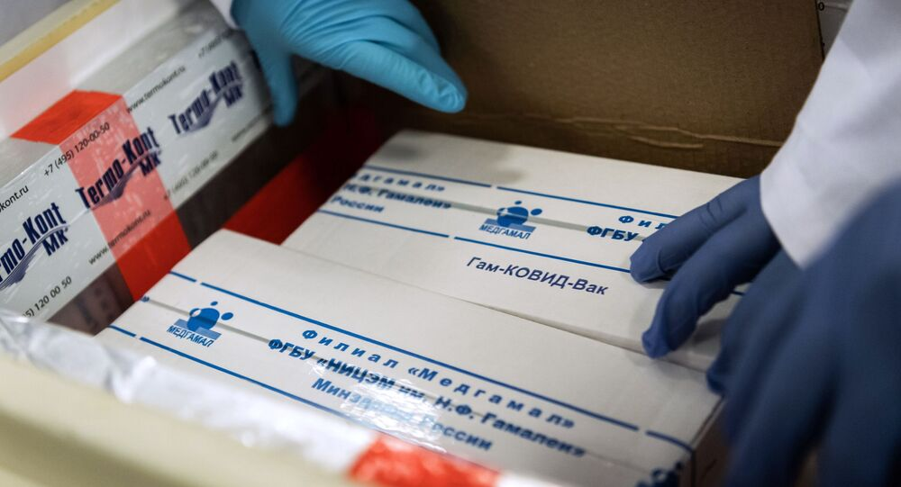 In this handout photo released by Hungarian Foreign Ministry, laboratory assistants unpack Russia's coronavirus vaccine Gam-COVID-Vac, trade-named Sputnik V, in Budapest, Hungary
