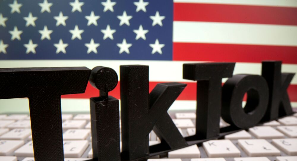 A 3D printed TikTok logo is placed on a keyboard in front of U.S. flag in this illustration taken October 6, 2020.