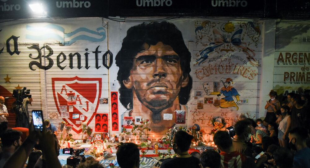 People gather to mourn the death of soccer legend Diego Maradona, outside the Diego Armando Maradona stadium, in Buenos Aires, Argentina November 25, 2020
