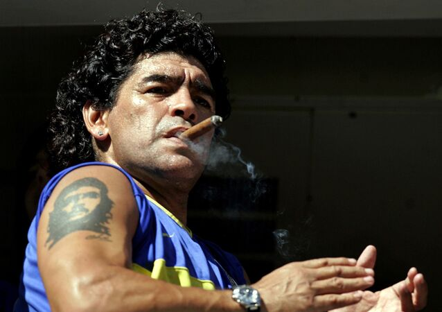 FILE PHOTO: Former Argentine soccer star Diego Maradona smokes a cigar before the start of the Argentine First Division soccer match between Boca Juniors and San Lorenzo de Almagro at La Bombonera stadium in Buenos Aires February 19, 2006