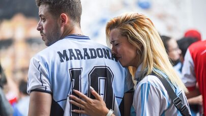 People gather to mourn the death of soccer legend Diego Maradona, outside the Diego Armando Maradona Stadium, in Buenos Aires, Argentina 25 November 2020.