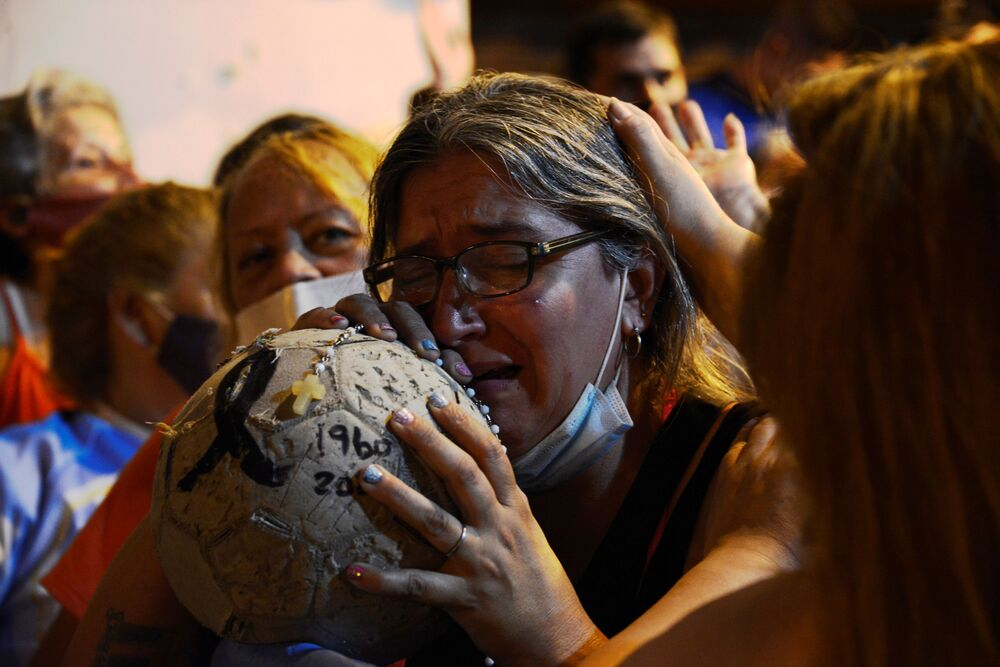 People mourn soccer legend Diego Maradona outside the morgue where his body is being held, in Buenos Aires, Argentina 25 November 2020.