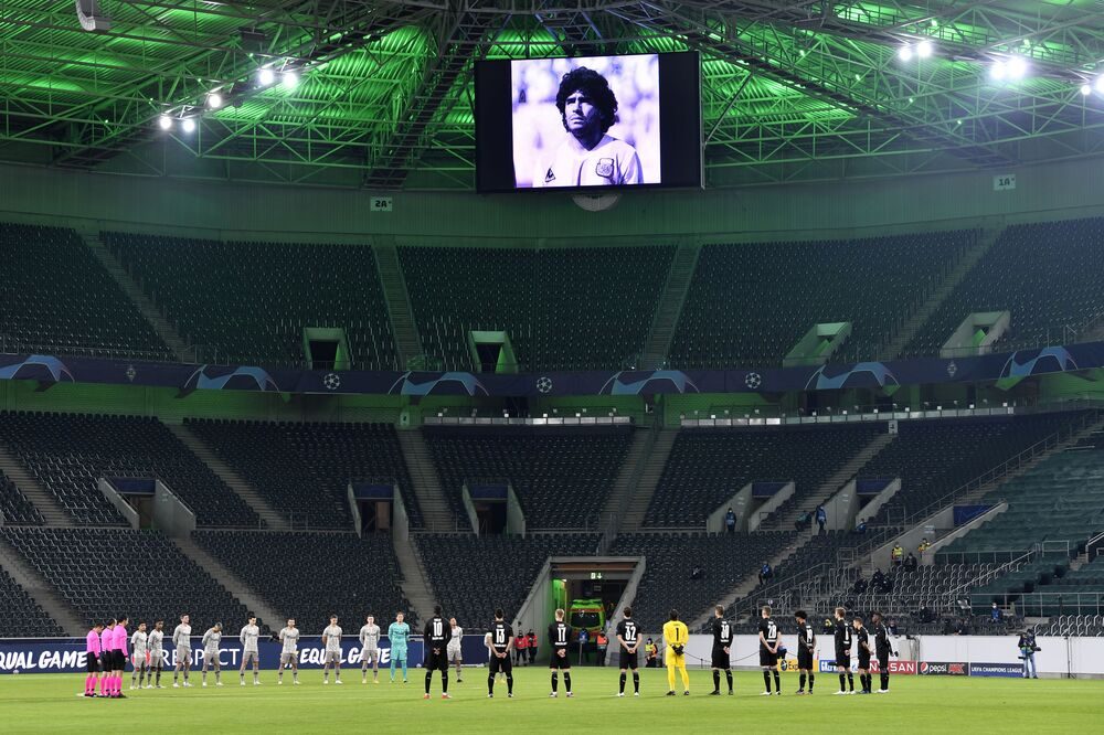 Players observe a minute of silence for former Argentina soccer great Diego Armando Maradona before the Champions League, Group B, soccer match between Borussia Moenchengladbach and Shakhtar Donetsk at Borussia Park in Moenchengladbach, Germany, Wednesday, 25 Nov. 2020.