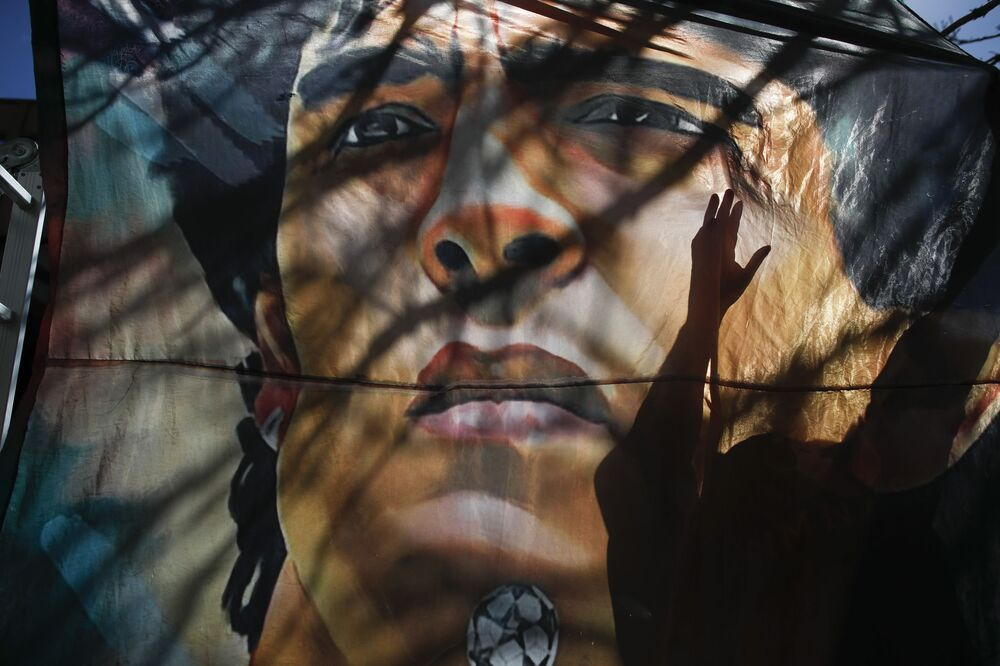 A banner with former soccer star Diego Maradona hangs outside the hospital where he was hospitalised in La Plata, Argentina, Tuesday, 3 Nov. 2020.