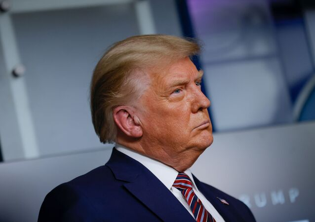 U.S. President Donald Trump listens to administration officials after speaking about prescription drug prices during an appearance in the Brady Press Briefing Room at the White House in Washington, U.S., November 20, 2020