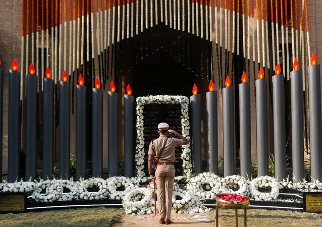 A police officer pays his respects at a memorial to mark the 12th anniversary of the November 26, 2008 attacks, in Mumbai, India November 26, 2020