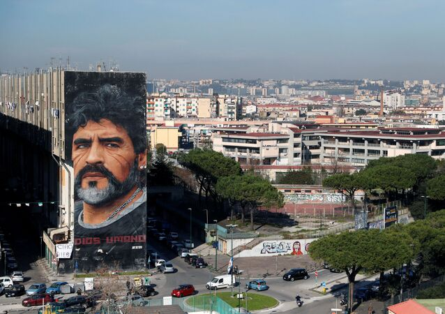 A general view shows a mural by artist Jorit depicting late Argentine soccer legend Diego Maradona, in Naples, Italy November 26, 2020