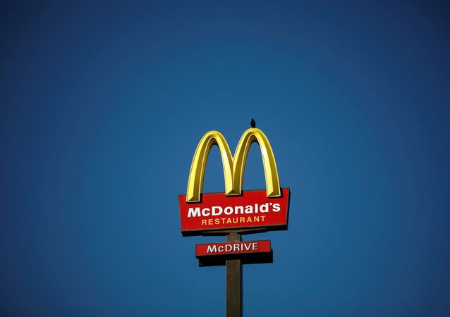 The McDonald's company logo stands on a sign outside a restaurant in Bretigny-sur-Orge, near Paris, France, July 30, 2020.